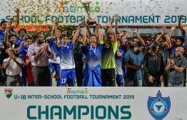 Villa International High School lifts the U-19 interschool football trophy. PHOTO: NISHAN ALI / MIHAARU