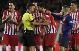 "(FILES) In this file photo taken on April 6, 2019 Atletico Madrid's Spanish forward Diego Costa (C-R) argues with Spanish referee Gil Manzano before receiving a red card during the Spanish league football match between FC Barcelona and Club Atletico de Madrid at the Camp Nou stadium in Barcelona. - Costa will miss the rest of the season after being handed an eight-match suspension by the Spanish Football Federation on April 11, 2019. Costa was sent off in the first half of Atletico's 2-0 defeat to Barcelona for directing a crude insult towards referee Gil Manzano. Manzano also reported that Costa had ""grabbed"" him by the arms during the incident. (Photo by LLUIS GENE / AFP)"