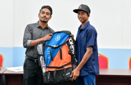 Kiteboarder Hassan Mahir and Deputy Minister of Youth, Sports and Community Empowerment. PHOTO: NISHAN ALI / MIHAARU