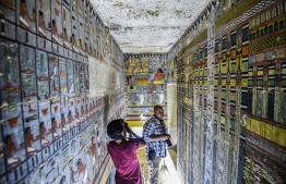 "This picture taken on April 13, 2019 shows journalists filming inside the newly-dicovered tomb of the ancient Egyptian nobleman ""Khewi"" dating back to the 5th dynasty (2494–2345 BC), at the Saqqara necropolis, about 35 kilometres south of the capital Cairo. Mohamed el-Shahed / AFP"