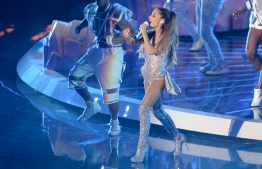 In this file photo taken on August 24, 2014 Ariana Grande  performs on stage at the MTV Video Music Awards (VMA) at The Forum in Inglewood, California. - Bubblegum pop coquette on the outside, saucy master of celebrity on the inside, there is perhaps no current star better at parlaying her own trials into larger-than-life success than Ariana Grande. (Photo by Robyn BECK / AFP)