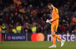 Manchester United's Spanish goalkeeper David De Gea leaves after the UEFA Champions League quarter-final second leg football match between Barcelona and Manchester United at the Camp Nou stadium in Barcelona on April 16, 2019. (Photo by Josep LAGO / AFP)