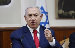 Israeli Prime Minister Benjamin Netanyahu faces a period of coalition negotiations [Ronen Zvulun/Pool via The Associated Press]