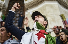 Algerian students shout slogans as they demonstrate with national flags outside La Grande Poste (main post office) in the centre of the capital Algiers on March 10, 2019 against ailing Algerian President Abdelaziz Bouteflika's bid for a fifth term. PHOTO: RYAD KRAMDI / AFP