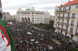 Algerians take part in a demonstration against ailing President Abdelaziz Bouteflika in front of La Grande Poste (main post office) in the centre of the capital Algiers on March 22, 2019. - Bouteflika said on February 22 he would run for a fifth term in April 18 elections, despite concerns about his ability to rule. The 82-year-old uses a wheelchair and has rarely appeared in public since suffering a stroke in 2013. Following initial protests, he made the surprise announcement on March 11 that he was pulling out of the race -- and also postponed the polls. PHOTO: AFP