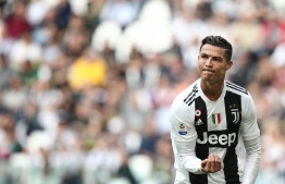 Juventus' Portuguese forward Cristiano Ronaldo gestures during the Italian Serie A football match Juventus vs Fiorentina on April 20, 2019 at the Juventus stadium in Turin. (Photo by Isabella BONOTTO / AFP)