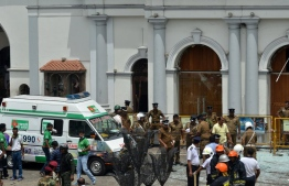 Police and relevant authorities responding to the bomb blasts that took place in three churches and three hotels in Sri Lanka on Sunday morning. PHOTO: AFP