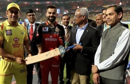 Captains of two Indian cricket teams presenting President Ibrahim Mohamed Solih with a cricket bat. PHOTO: MIHAARU FILES