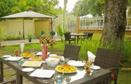 A lunch spread served in Veyli Residence garden. PHOTO: HAWWA AMAANY ABDULLA / THE EDITION