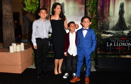 "From the cast, (from L) Aiden Lewandowski, Marisol Ramirez, who plays La Llorona, Oliver Alexander and Jayden Valdivia arrive for the premiere of ""The Curse of La Llorona"" at the Egyptian Theater in Hollywood on April 15, 2019. (Photo by Frederic J. BROWN / AFP)"