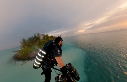 World-renowned, real-life Iron Man, Richard Browning, also known as 'the flying man',  soars above the lagoon of luxury resort One and Only Reethi Rah,  in his jet-powered superhero suit. PHOTO: SCREENGRAB / O&O REETHI RAH