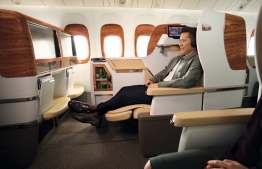 A passenger reclines within an Emirates aircraft. PHOTO: EMIRATES AIRLINE
