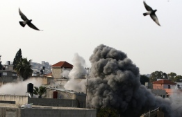 Israeli forces blow up the family house of Palestinian assailant Omar Abu Laila, in Az-Zawiya village, in the Israeli-occupied West Bank, April 24, 2019. - Israeli forces on March 19 shot dead a Omar Abu Laila, suspected of killing an Israeli rabbi and a soldier in the occupied West Bank, the Shin Bet internal security service said. Troops, police and security agents surrounded a building in the West Bank village of Abwein, north of Ramallah, in which the suspect was hiding according to a Shin Bet statement. The suspect, Omar Amin Abu Laila, opened fire and was killed in the shootout, Shin Bet said. (Photo by JAAFAR ASHTIYEH / AFP)