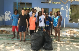 UN Resident Representative to Maldives Shoko Noda participating in a clean-up event hosed by Save The Beach. PHOTO: NODA