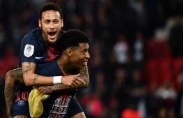 Paris Saint-Germain's Brazilian forward Neymar (Up) celebrates with Paris Saint-Germain's French defender Presnel Kimpembe after winning the French L1 football match between Paris Saint-Germain (PSG) and Monaco (ASM) on April 21, 2019 at the Parc des Princes stadium in Paris. (Photo by Anne-Christine POUJOULAT / AFP)