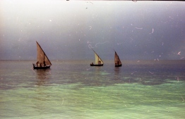 Three sail dhonis (traditional boat) in the lagoon of a Maldivian island. PHOTO: FRANK BURNABY