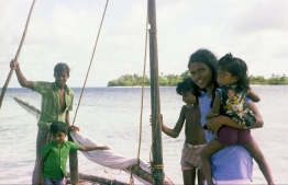 A bunch of Maldivian children on a sail dhoni (traditional boat). PHOTO: FRANK BURNABY