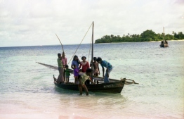 A sail dhoni (traditional boat) full of passengers being pulled to shore. PHOTO: FRANK BURNABY