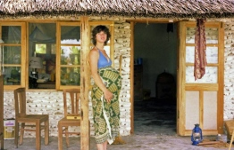 Gayle during her pregnancy in front of the house built for the family by people of Bodufolhudhoo. PHOTO: FRANK BURNABY