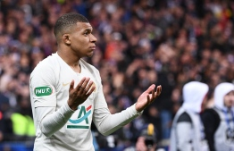 Paris Saint-Germain's French forward Kylian Mbappe leaves the pitch after receiving a red card during the French Cup final football match between Rennes (SRFC) and Paris Saint-Germain (PSG), on April 27, 2019 at the Stade de France in Saint-Denis, outside Paris. (Photo by Martin BUREAU / AFP)