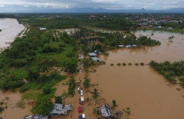 This aerial picture taken on April 27, 2019 shows a general view of submerged buildings after heavy rain caused flooding in Bengkulu on the Indonesian island of Sumatra. - At least 10 people are dead and eight are missing after days of heavy rain-triggered floods and landslides on the Indonesian island of Sumatra, authorities said on April 28. (Photo by DIVA MARHA / AFP)