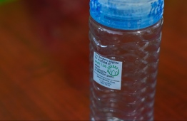 A bottle with the sticker used in Project 'Rahdhu'. Only bottles with this sticker are eligible for the incentive. PHOTO: HUSSAIN WAHEED / MIHAARU.