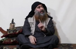 """In this undated tv grab taken from a video released by Al-Furqan media, the chief of the Islamic State group Abu Bakr al-Baghdadi purportedly appears for the first time in five years in a propaganda video in an undisclosed location. - The elusive chief of the IS group al-Baghdadi has appeared for the first time in five years in a propaganda video released on April 29 by the jihadist organisation. It is unclear when the footage was filmed, but Baghdadi referred in the past tense to the months-long fight for Baghouz, IS's final bastion in eastern Syria, which ended last month. (Photo by - / various sources / AFP) / THIS PICTURE WAS MADE AVAILABLE BY A THIRD PARTY. AFP CAN NOT INDEPENDENTLY VERIFY THE AUTHENTICITY, LOCATION, DATE AND CONTENT OF THIS IMAGE. THIS PHOTO IS DISTRIBUTED EXACTLY AS RECEIVED BY AFP. RESTRICTED TO EDITORIAL USE - MANDATORY CREDIT """"AFP PHOTO / SOURCE / AL-FURQAN"""" - NO MARKETING - NO ADVERTISING CAMPAIGNS - DISTRIBUTED AS A SERVICE TO CLIENTS /"""