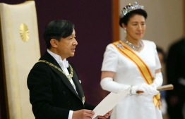Japan's new Emperor Naruhito (L) delivers his speech as new Empress Masako (R) stands next to him during a ceremony to receive the first audience after the accession to the throne at the Matsu-no-Ma state room inside the Imperial Palace in Tokyo on May 1, 2019. Japan's new Emperor Naruhito formally ascended the Chrysanthemum Throne on May 1, a day after his father abdicated from the world's oldest monarchy and ushered in a new imperial era. PHOTO/AFP
