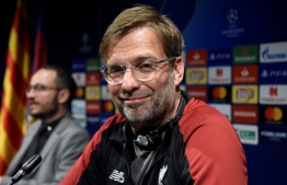 Liverpool's German coach Jurgen Klopp smiles during a press conference at the Camp Nou Stadium in Barcelona on April 30, 2019 on the eve of the UEFA Champions League semi-final first leg football match between Barcelona and Liverpool. PHOTO: JOSEP LAGO / AFP