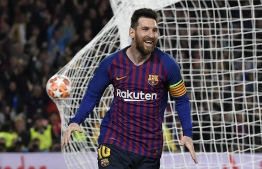 Barcelona's Argentinian forward Lionel Messi celebrates after scoring a goal during the UEFA Champions League semi-final first leg football match between Barcelona and Liverpool at the Camp Nou Stadium in Barcelona on May 1, 2019. (Photo by LLUIS GENE / AFP)