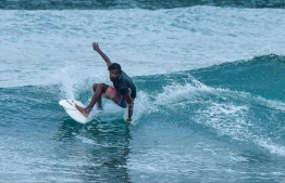 Ahmed Agil from Thuludhoo, Kaafu Atoll, surfing during the recently held 'The Trials' competition held by Maldives Surfing Association. PHOTO: HUSSEIN WAHEED/ MIHAARU
