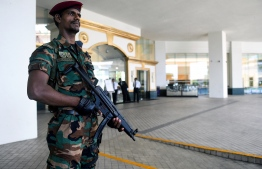 In this picture taken on May 1, 2019, a Sri Lankan soldier stands guard at the entrance of the Cinnamon Grand hotel lobby in Colombo. - On April 21, the Cinnamon was one of three hotels hit by jihadi bombers along with three churches in attacks claimed by the Islamic State group that left 257 people dead. (Photo by ISHARA S.  KODIKARA / AFP) /