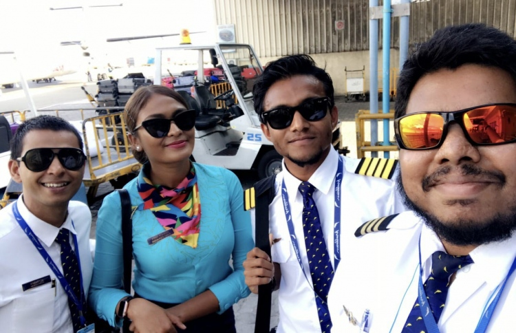 Mohamed Zaffan (2-R) and crew, after touching down on his maiden flight as captain. PHOTO: MIHAARU FILES