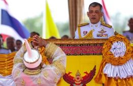 Thailand's King Maha Vajiralongkorn (R) presides the annual royal ploughing ceremony near the Grand Palace in Bangkok on May 9, 2019. (Photo by Krit Phromsakla Na SAKOLNAKORN / THAI NEWS PIX / AFP)