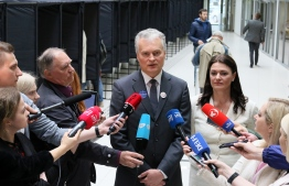 Lithuanian presidential candidate, economist Gitanas Nauseda, speaks to the media during an early vote, two days ahead of the presidential elections, at a polling station in Vilnius, Lithuania on May 10, 2019. - For all its economic growth, income inequality and poverty are top election issues as Lithuanians vote on May 12, 2019 for a new president in round one of a tight race in the Baltic eurozone state. Nine candidates are vying to replace two-term independent incumbent Dalia Grybauskaite, but surveys show that only three stand any real chance of making it to the expected May 26 run-off coinciding with European parliament elections. (Photo by Petras Malukas / AFP)