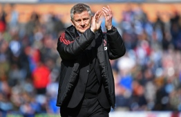 Manchester United's Norwegian manager Ole Gunnar Solskjaer applauds supporters after the English Premier League football match between Huddersfield Town and Manchester United at the John Smith's stadium in Huddersfield, northern England on May 5, 2019. - Manchester United fail to qualify for the Champions League after 1-1 draw at Huddersfield. PHOTO: PAUL ELLIS / AFP