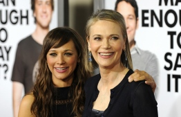 "FILES) In this file photo taken on March 17, 2009 Actress Rashida Jones and her mother actress Peggy Lipton (R) arrive at the premiere of ""I Love You, Man"" held at Mann's Village Theater in Westwood, California. Actress Peggy Lipton known for her role in the series ""The Mod Squad"" and ""Twin Peaks,"" died, she was 72. Her daughters Kidada and Rashida Jones announced on May 11, 2019 she lost her battle with cancer. Gabriel BOUYS / AFP"