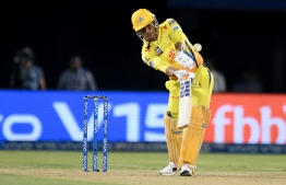Chennai Super Kings cricket captain Mahendra Singh Dhoni plays a shot during the 2019 Indian Premier League (IPL) second qualifier Twenty20 cricket match between Delhi Capitals and Chennai Super Kings at the Dr. Y.S. Rajasekhara Reddy ACA-VDCA Cricket Stadium in Visakhapatnam on May 10, 2019. (Photo by NOAH SEELAM / AFP) /