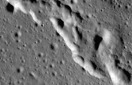 "In this image, a mosaic composed of many images taken by NASA's Lunar Reconnaissance Orbiter (LRO), and released by NASA on May 13, 2019, show wrinkle ridges in a region of the Moon called Mare Frigoris. - The Moon is steadily shrinking, causing wrinkling on its surface and quakes, according to an analysis of imagery captured by NASA's Lunar Reconnaissance Orbiter (LRO) published Monday May 13, 2019. (Photo by HO / NASA / AFP) / RESTRICTED TO EDITORIAL USE - MANDATORY CREDIT ""AFP PHOTO / NASA/ HO"" - NO MARKETING NO ADVERTISING CAMPAIGNS - DISTRIBUTED AS A SERVICE TO CLIENTS"