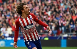 (FILES) In this file photo taken on February 9, 2019 Atletico Madrid's French forward Antoine Griezmann celebrates after scoring during the Spanish league football match Club Atletico de Madrid against Real Madrid CF at the Wanda Metropolitano stadium in Madrid. - French striker Antoine Griezmann has told Atletico Madrid he will leave them in the close season, the Spanish club said on Twitter on May 14, 2019. The 28-year-old Griezmann has a contract until 2023 with Atletico, but has a buy out clause of 120million euros ($134million) and has been the target of several approaches from La Liga rivals Barcelona. (Photo by PIERRE-PHILIPPE MARCOU / AFP)