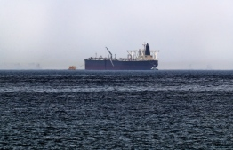 """A picture taken on May 13, 2019, shows the crude oil tanker, Amjad, which was one of two Saudi tankers that were reportedly damaged in mysterious """"sabotage attacks"""", off the coast of the Gulf emirate of Fujairah. - Saudi Arabia said two of its oil tankers were damaged in mysterious """"sabotage attacks"""" in the Gulf as tensions soared in a region already shaken by a standoff between the United States and Iran. (Photo by KARIM SAHIB / AFP)"""