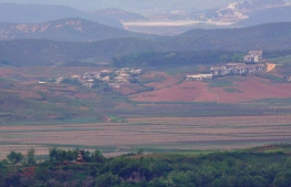 """North Korea's border county of Kaepoong is seen from a South Korean observation post in Paju near the Demilitarized Zone (DMZ) dividing the two Koreas on May 17, 2019. - North Korea is experiencing its worst drought in over a century, official media reported on May 17, days after the World Food Programme expressed """"serious concerns"""" about the situation in the country. (Photo by Jung Yeon-je / AFP)"""