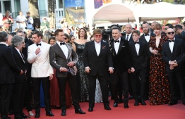 """(FromL) British director Dexter Fletcher, British actor Richard Madden, British actor Taron Egerton, British singer-songwriter Elton John, his husband Canadian producer David Furnish, British Actor Kit Connor, US actress Bryce Dallas Howard and British songwriter Bernie Taupin arrive for the screening of the film """"Rocketman"""" at the 72nd edition of the Cannes Film Festival in Cannes, southern France, on May 16, 2019. (Photo by LOIC VENANCE / AFP)"""