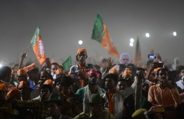 Bharatiya Janata Party (BJP) supporters attend a rally as Indian Prime Minister Narendra Modi  delivers a speech during a rally ahead of Phase VI of India's general election in Allahabad on May 9, 2019. (Photo by SANJAY KANOJIA / AFP)
