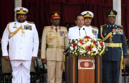 Sri Lankan President Maithripala Sirisena (C) delivers a speech during the National War Heroes Day in Colombo on May 19, 2019. - Sri Lanka's president marked the 10th anniversary of the end of a protracted war with Tamil rebels on May 19 by vowing to crush Islamist militants responsible for Easter bombings that killed 258 people. (Photo by LAKRUWAN WANNIARACHCHI / AFP)