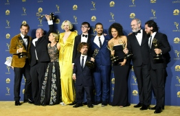 "(FILES) In this file photo taken on September 17, 2018 The cast of Game of Thrones pose with the Emmy for Outstanding Drama Series during the 70th Emmy Awards at the Microsoft Theatre in Los Angeles. - The finale of ""Game of Thrones"" drew a staggering 19.3 million viewers in the US Sunday evening, cementing the fantasy epic's status as the most watched television series in HBO history. (Photo by VALERIE MACON / AFP)"