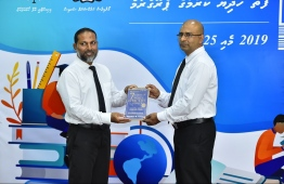 Home Minister Imran Abdulla (L) and Commissioner of Prisons Abdulla Munaz inaugurate the programme to donate books for prisons in Maldives. PHOTO: HUSSAIN WAHEED / MIHAARU
