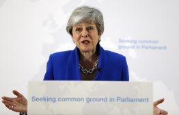 "Britain's Prime Minister Theresa May delivers a speech in central London on May 21, 2019. - British Prime Minister Theresa May on Tuesday outlined a series of incentives for MPs to support her Brexit deal, saying there was ""one last chance"" to end the deadlock. May called the draft legislation going before MPs next month a ""new Brexit deal"" to end the current political impasse which has delayed Brexit. (Photo by Kirsty Wigglesworth / POOL / AFP)"
