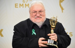 "(FILES) In this file photo taken on September 20, writer George R. R. Martin, winner of Outstanding Drama Series for ""Game of Thrones"", poses in the press room at the 67th Annual Primetime Emmy Awards at Microsoft Theater in Los Angeles, California. - ""Game of Thrones"" fans have been dissecting the series finale -- and complaining about it -- for two days now, but they may get another shot at elation, or disappointment. Martin has suggested the ending could be very different from the one seen worldwide when he finally publishes the final two books in the saga. (Photo by Jason Merritt / GETTY IMAGES NORTH AMERICA / AFP)"