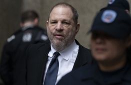 (FILES) In this file photo taken on April 25, 2019 disgraced Hollywood mogul Harvey Weinstein leaves the State Supreme Court in New York, after a break in a pre-trial hearing over sexual assault charges. - Disgraced Hollywood producer Harvey Weinstein has reached a provisional $44 million settlement with alleged victims and creditors, the Wall Street Journal reported on May 23, 2019. (Photo by Don Emmert / AFP)